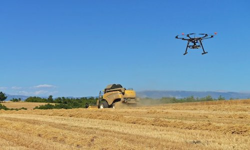 A drone hovering over a farm